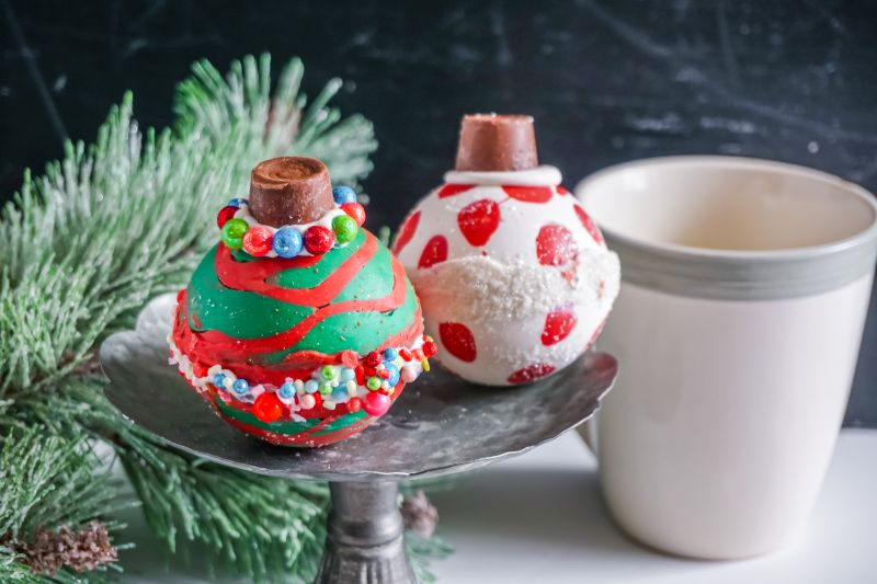 Christmas Ornament Hot Cocoa Bombs  on metal stand with coffee mug