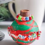 Christmas Ornament Hot Cocoa Bombs with coffee mug