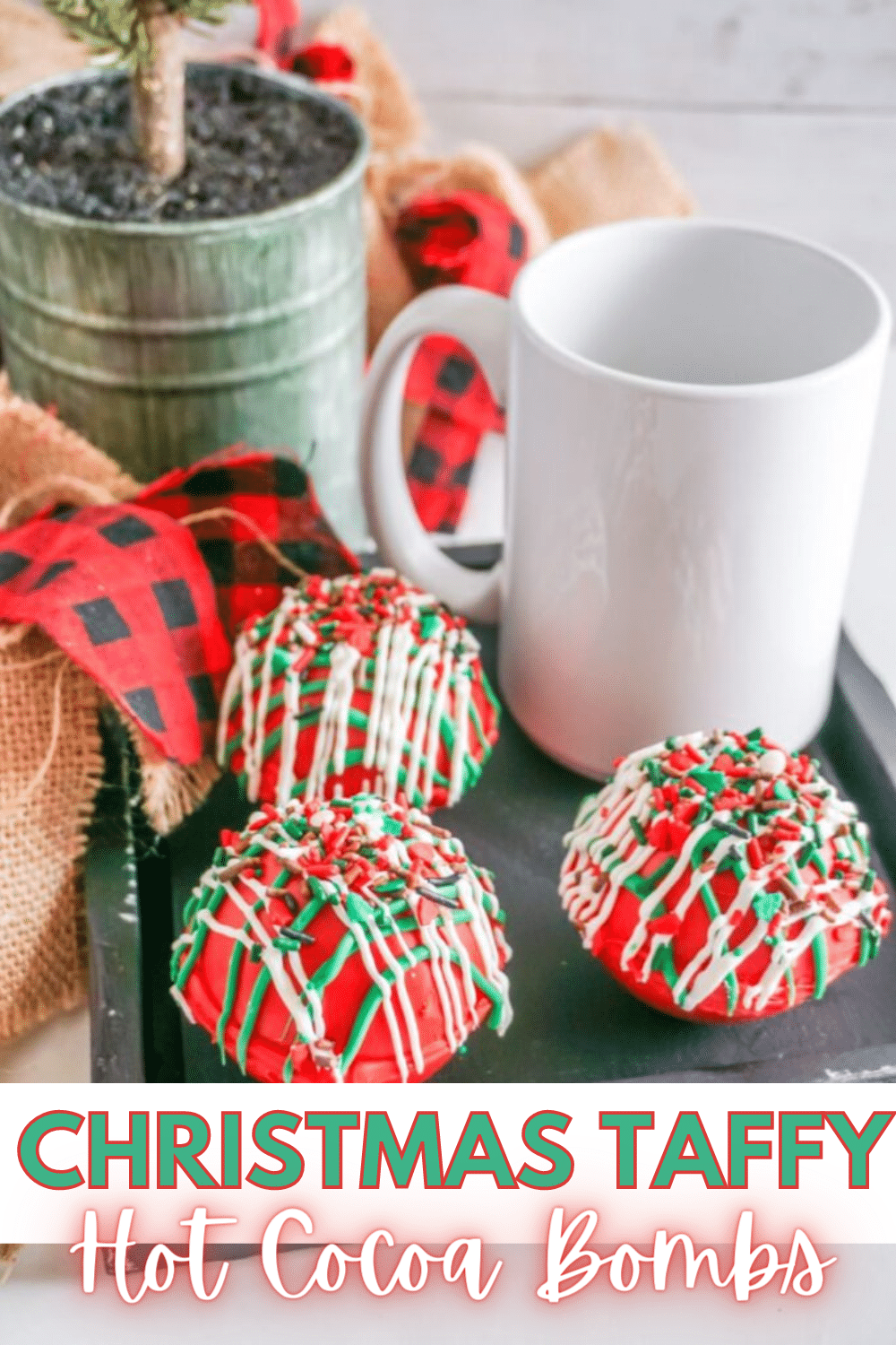 These Christmas Taffy Hot Cocoa Bombs are full of holiday fun! So simple and easy to make for the kids or for homemade gifts! #hotcocoabombs #hotcocoa #christmas #taffy #homemadegift via @wondermomwannab