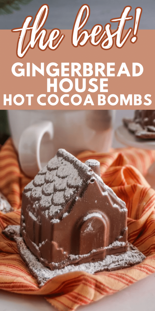 a closeup of a Gingerbread House Hot Cocoa Bomb next to a white mug on an orange and red cloth with title text reading the best! Gingerbread House Hot Cocoa Bombs