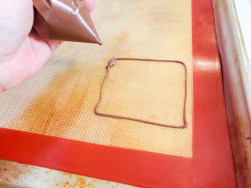 drawing a square using the melted chocolate