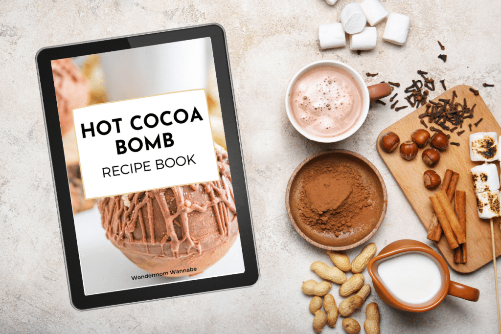 electronic device with the text Hot cocoa Bombs recipe book on the screen next to ingredients needed to make hot cocoa bombs