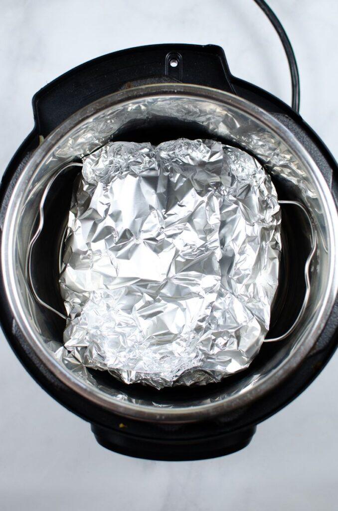 Salmon in aluminum foil in the instant pot.