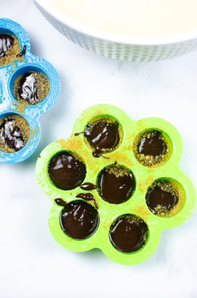 Chocolate ganache in egg moulds.