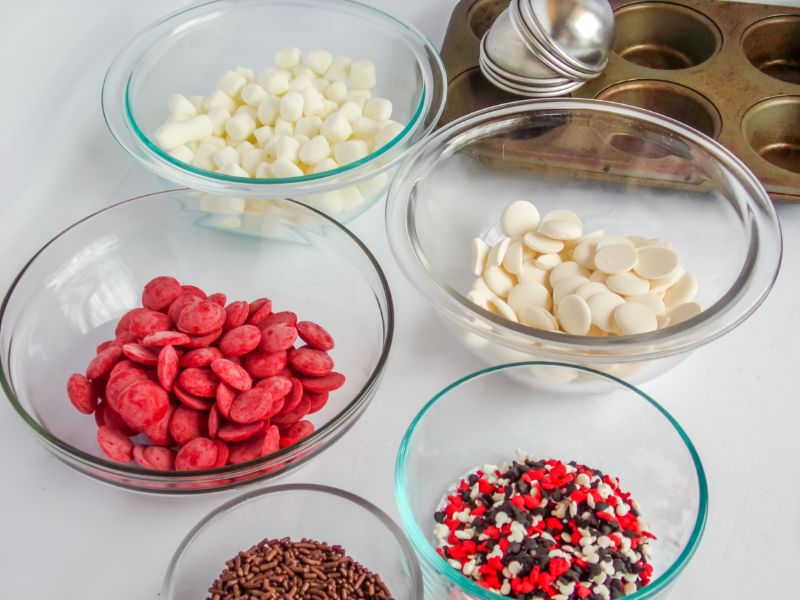ingredients in glass bowls needed for  Mickey Christmas Hot Cocoa Bombs