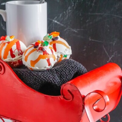 hot cocoa bombs in red sleigh