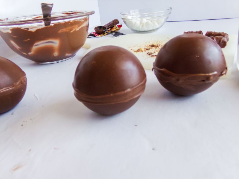 putting together the two chocolate halves