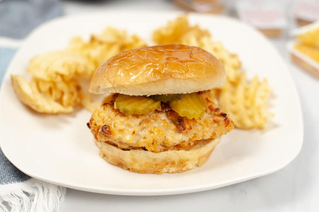 Air Fryer Copycat Chick-Fil-A Sandwich on white plate with waffle fries