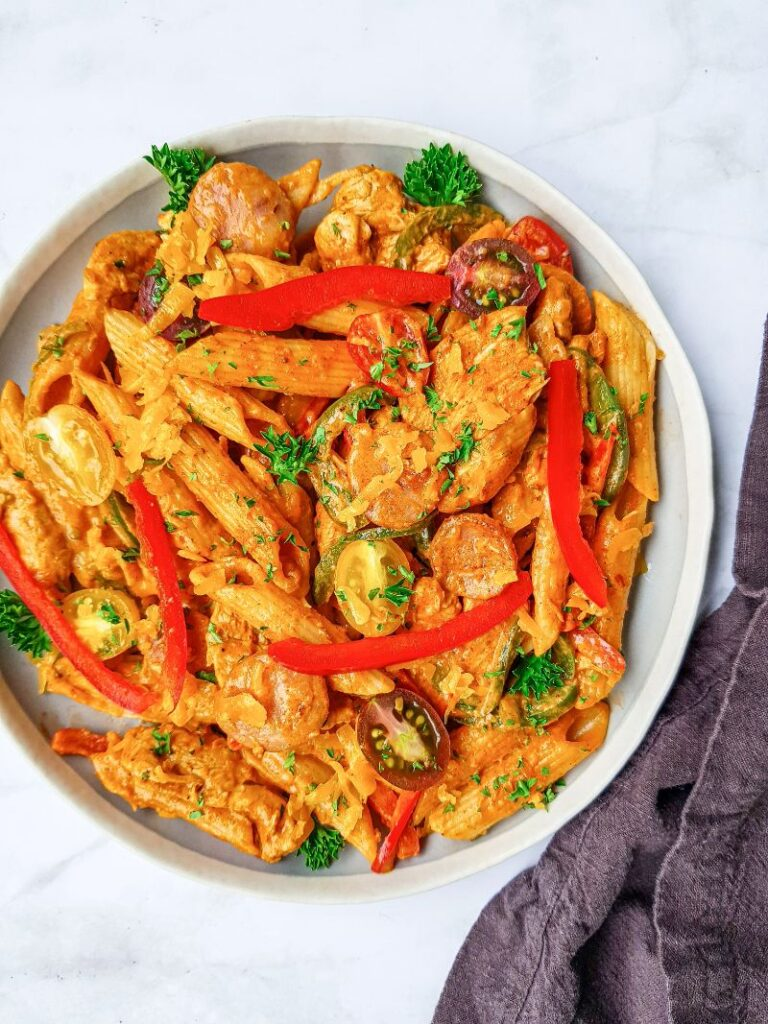 Cajun Chicken Pasta  in a white dish on a white counter