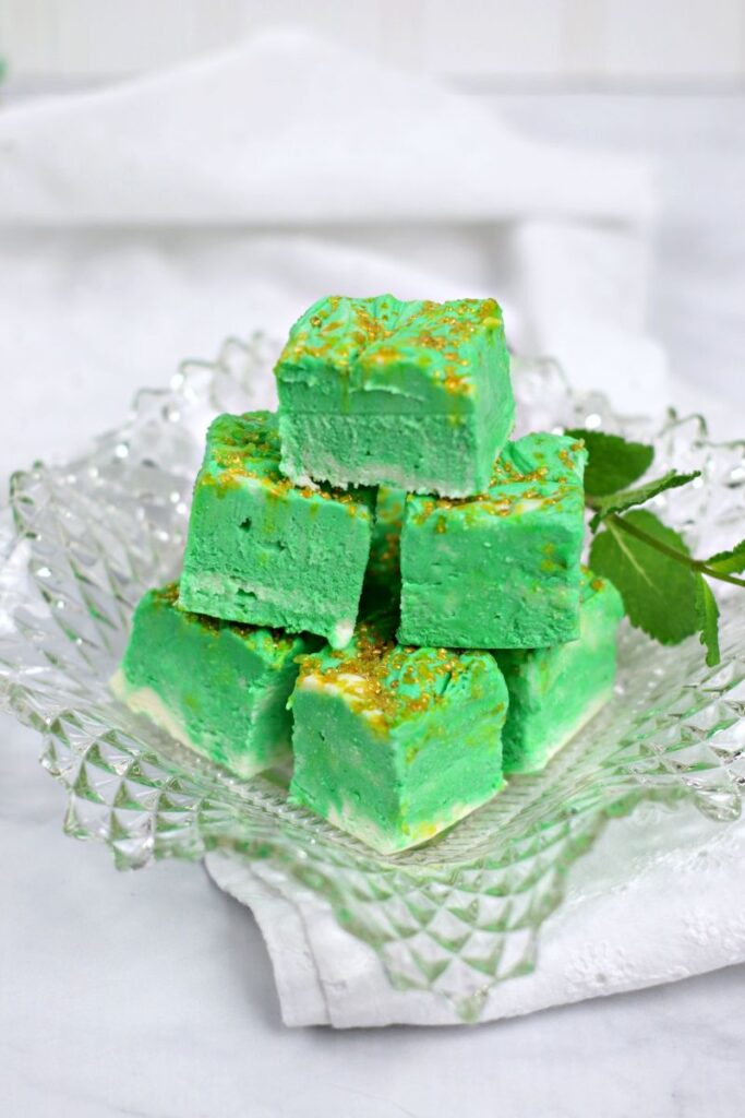 White Chocolate Mint Cheesecake Fudge on clear platter