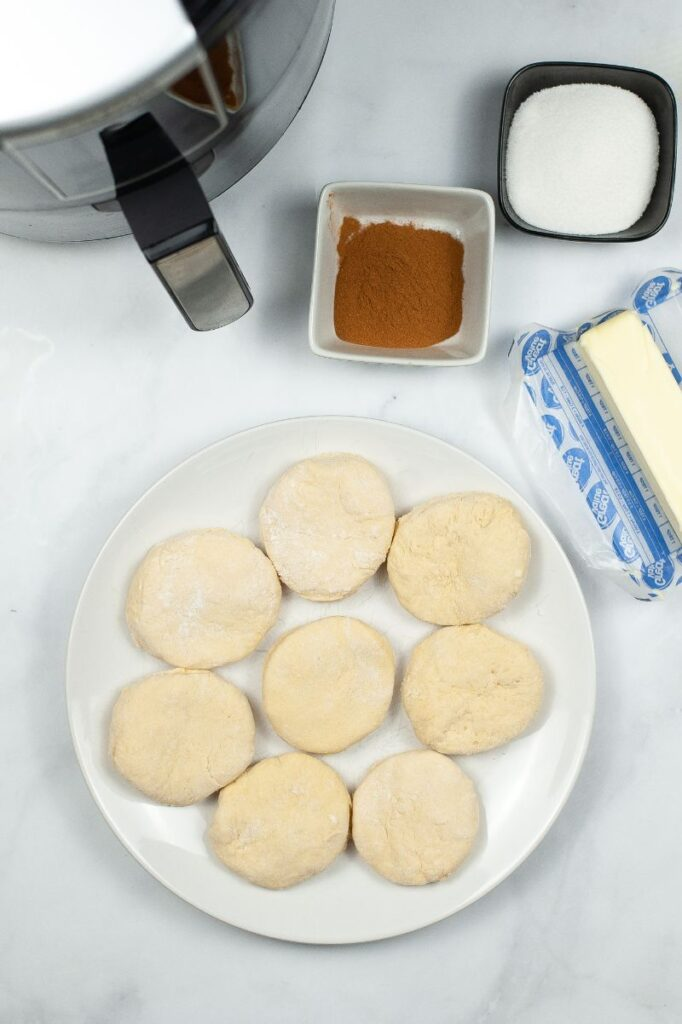 ingredients needed to make air fryer donuts and an air fryer