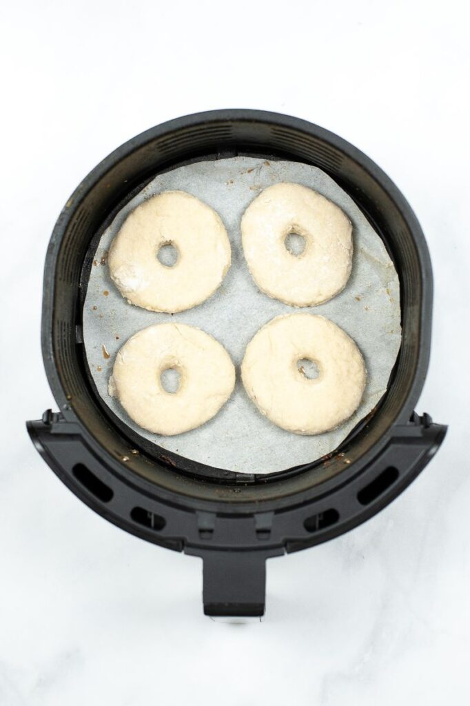 donuts in an air fryer before being cooked