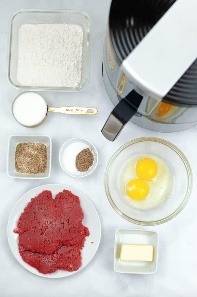 bowls of ingredients needed to make air fryer chicken fried steak