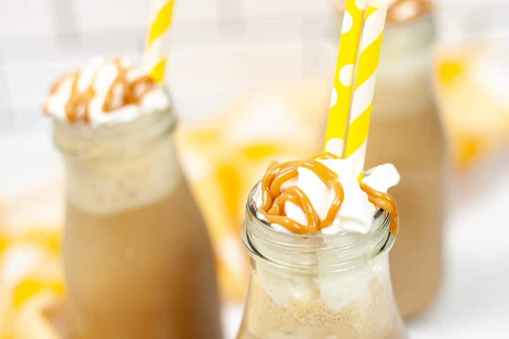 close up of three jars of Copycat Starbucks Iced Caramel Macchiato