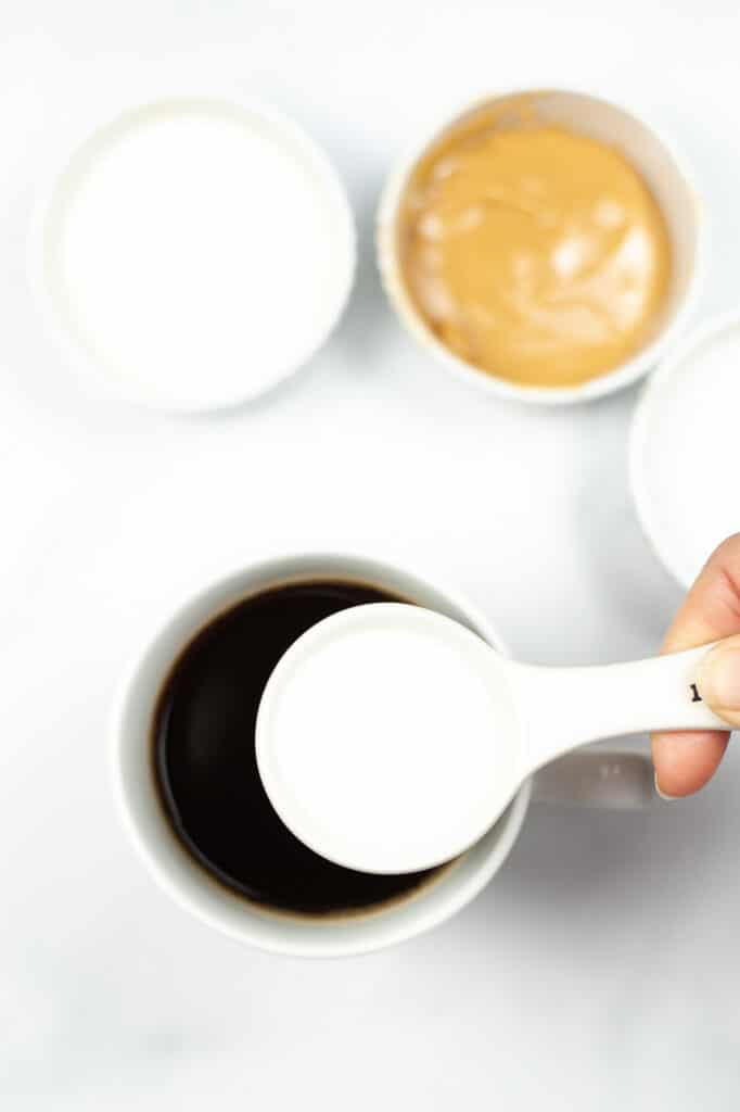 adding in sugar to the hot coffee