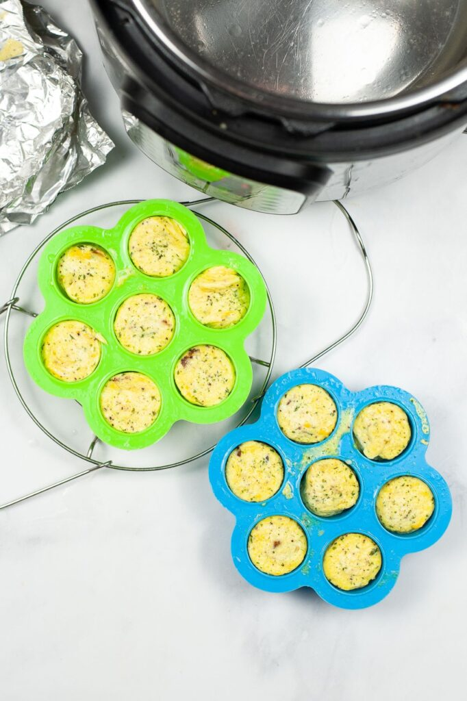 egg bites in molds on a cooling rack with an instant pot in the background