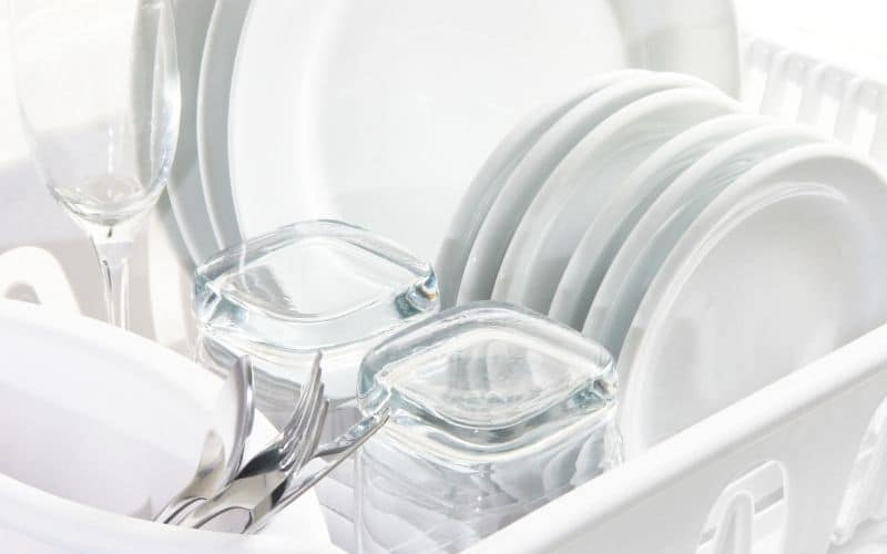 plates, glasses and silverware in a dishwasher