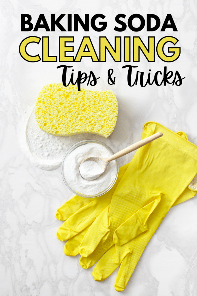 yellow rubber gloves, baking soda and a spoon in a glass bowl, and a yellow sponge on a white counter with title text reading Baking Soda Cleaning Tips & Tricks