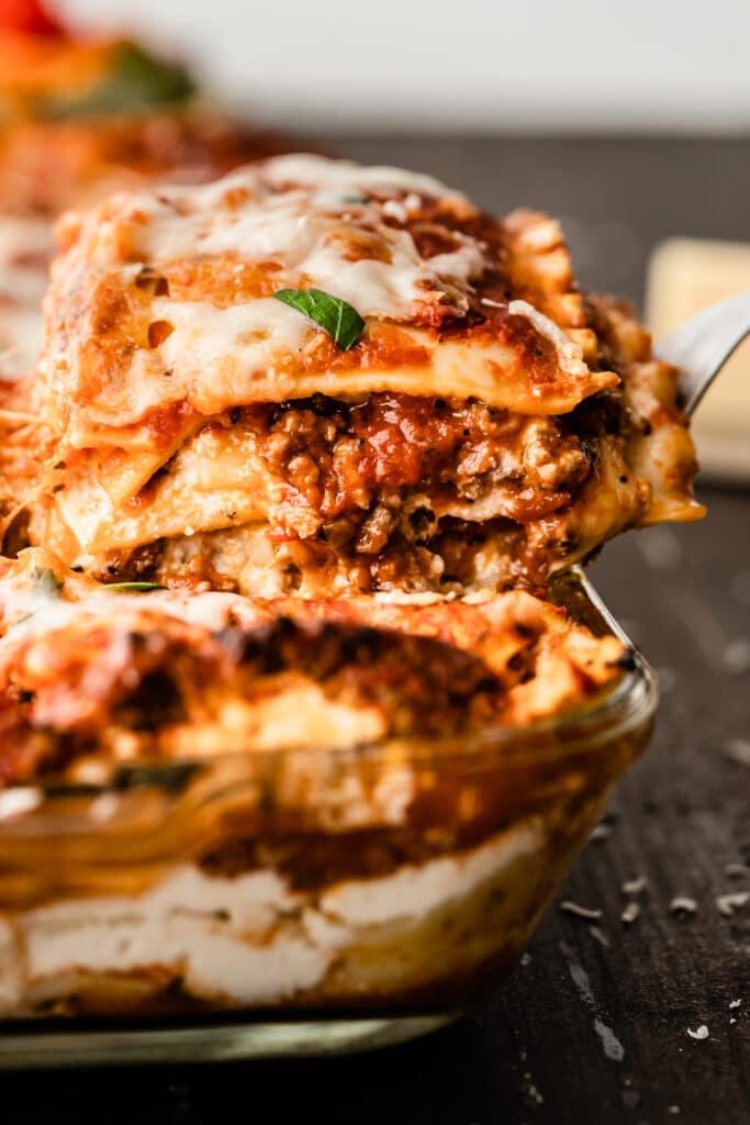 close up of a piece of lasagna on spatula
