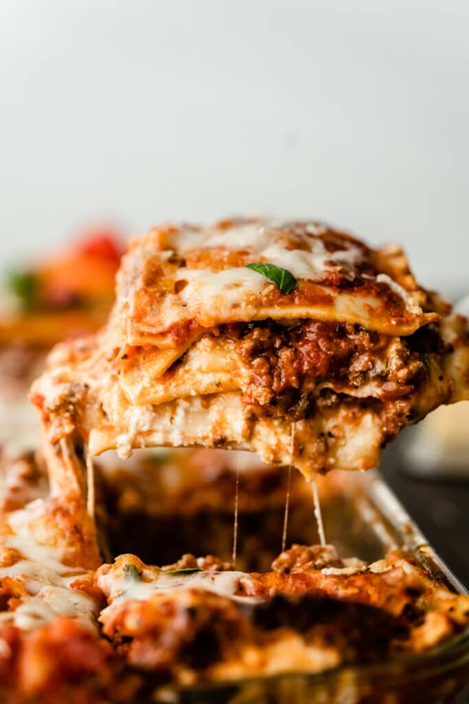 piece of lasagna being cut out of the pan