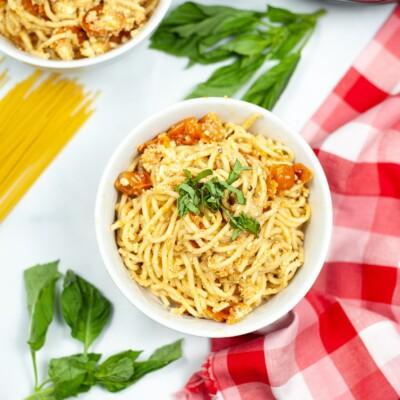 overhead view of white bowl of Instant Pot Tomato Feta Pasta recipe