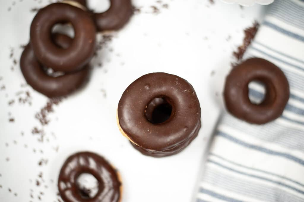 chocolate glazed donuts on a counter