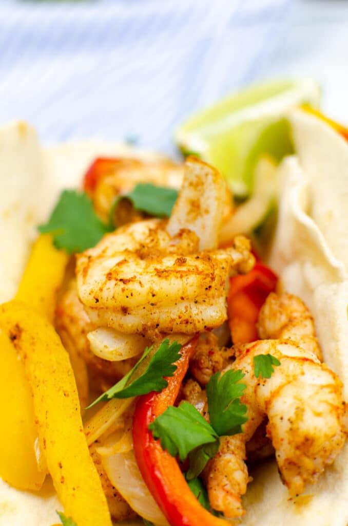 close up of shrimp fajitas