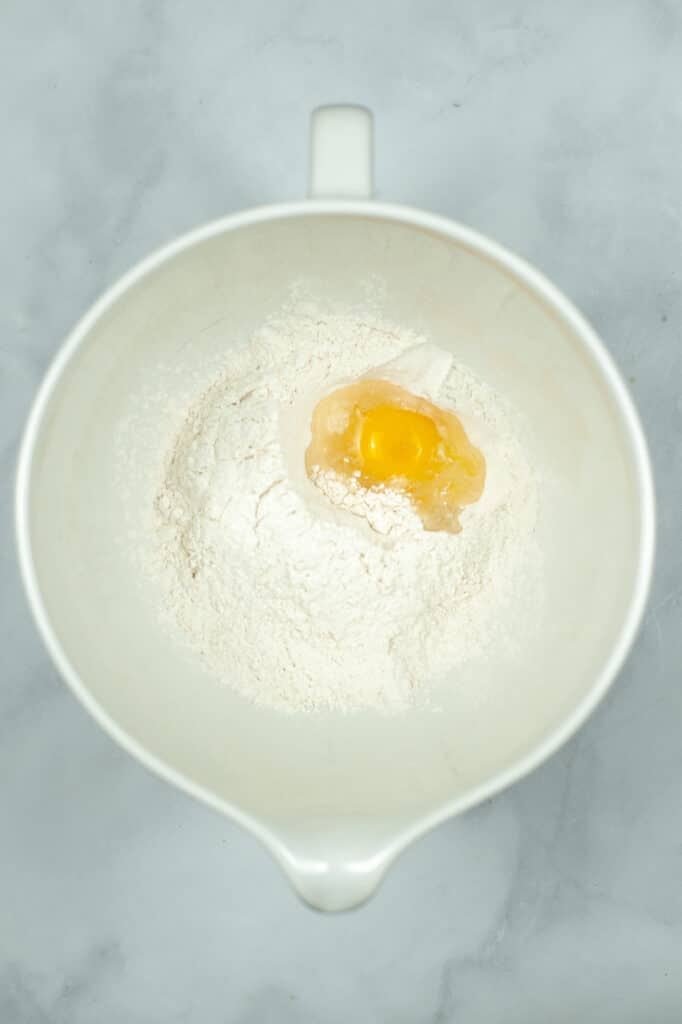 adding in the eggs to make the dough