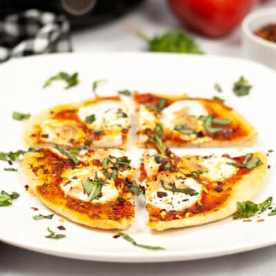 sliced pizza on white plate