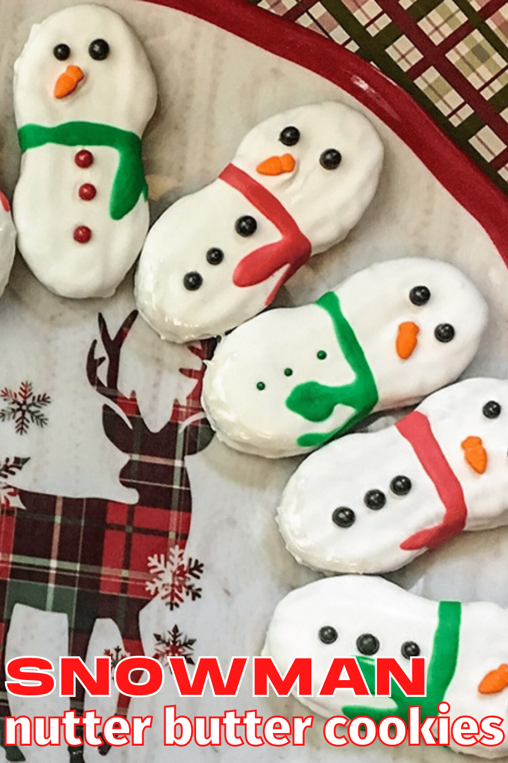 These Snowman Nutter Butter Cookies are an adorable winter treat and they're super easy to make! #nutterbutter #funfoodforkids #wintertreat via @wondermomwannab