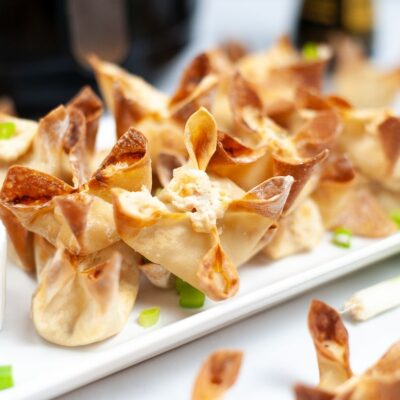 close up of crab rangoon on a rectangle plate