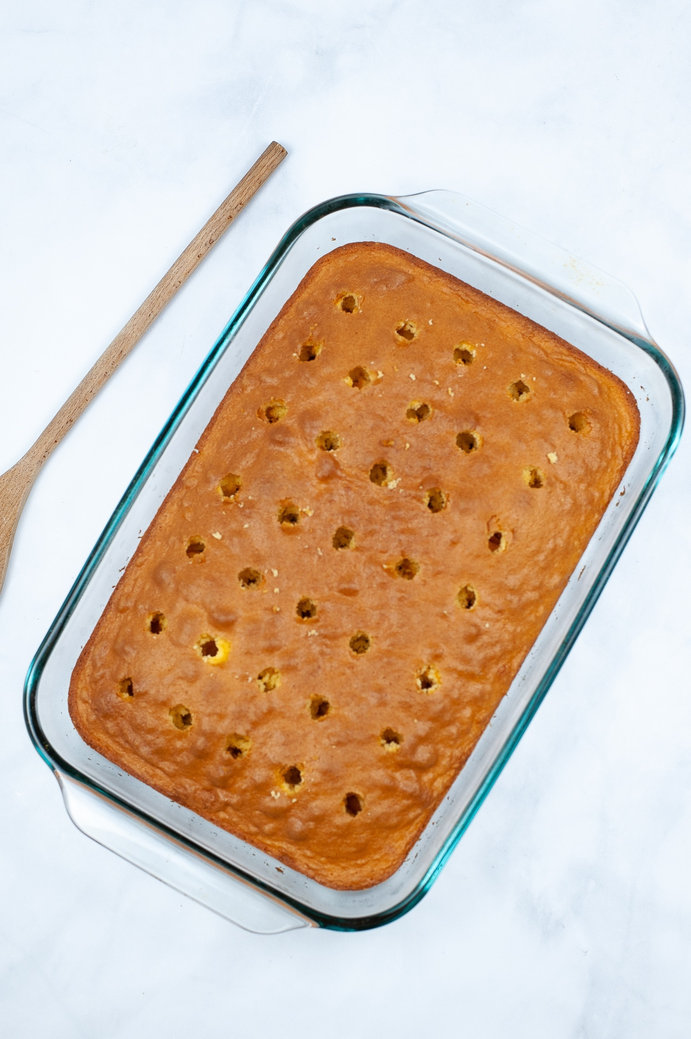 banana cake with holes poked in it