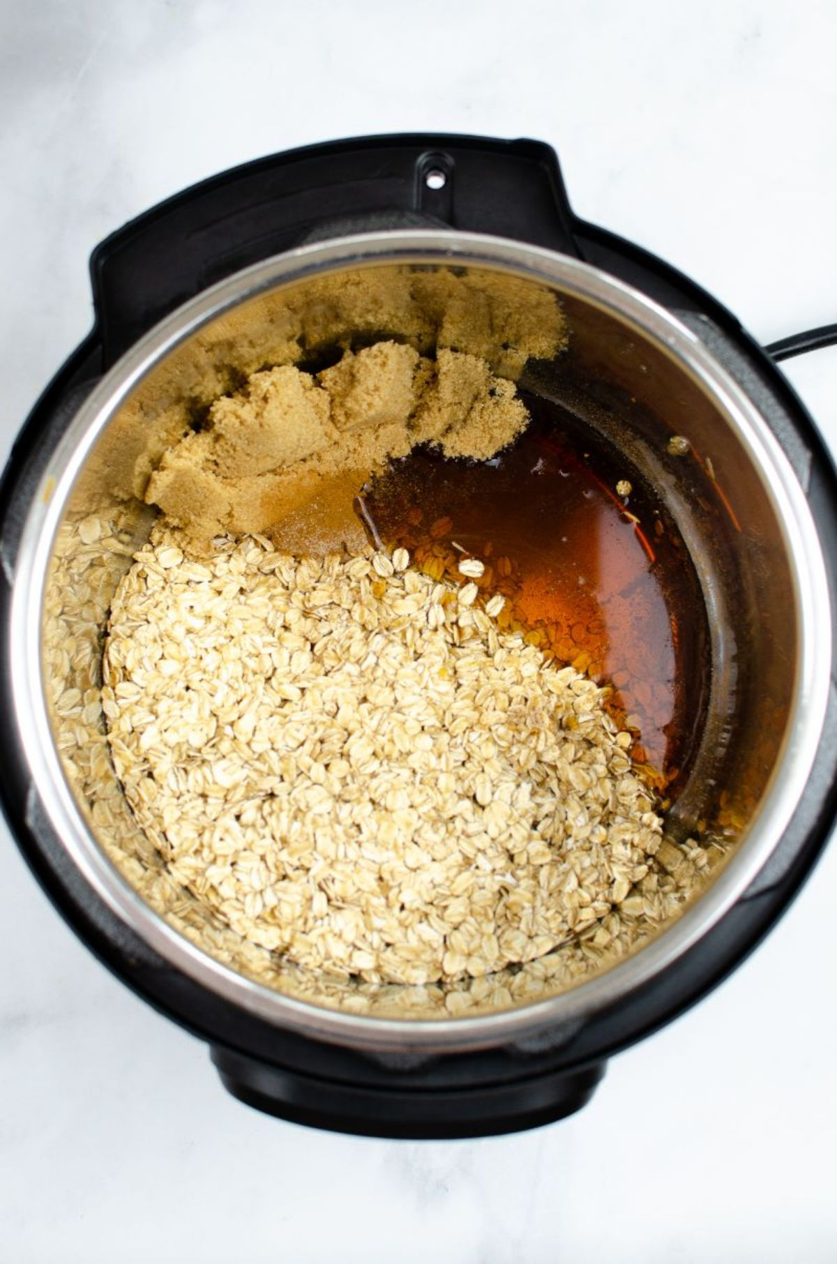 Ingredients for Instant Pot Oatmeal in an Instant Pot.