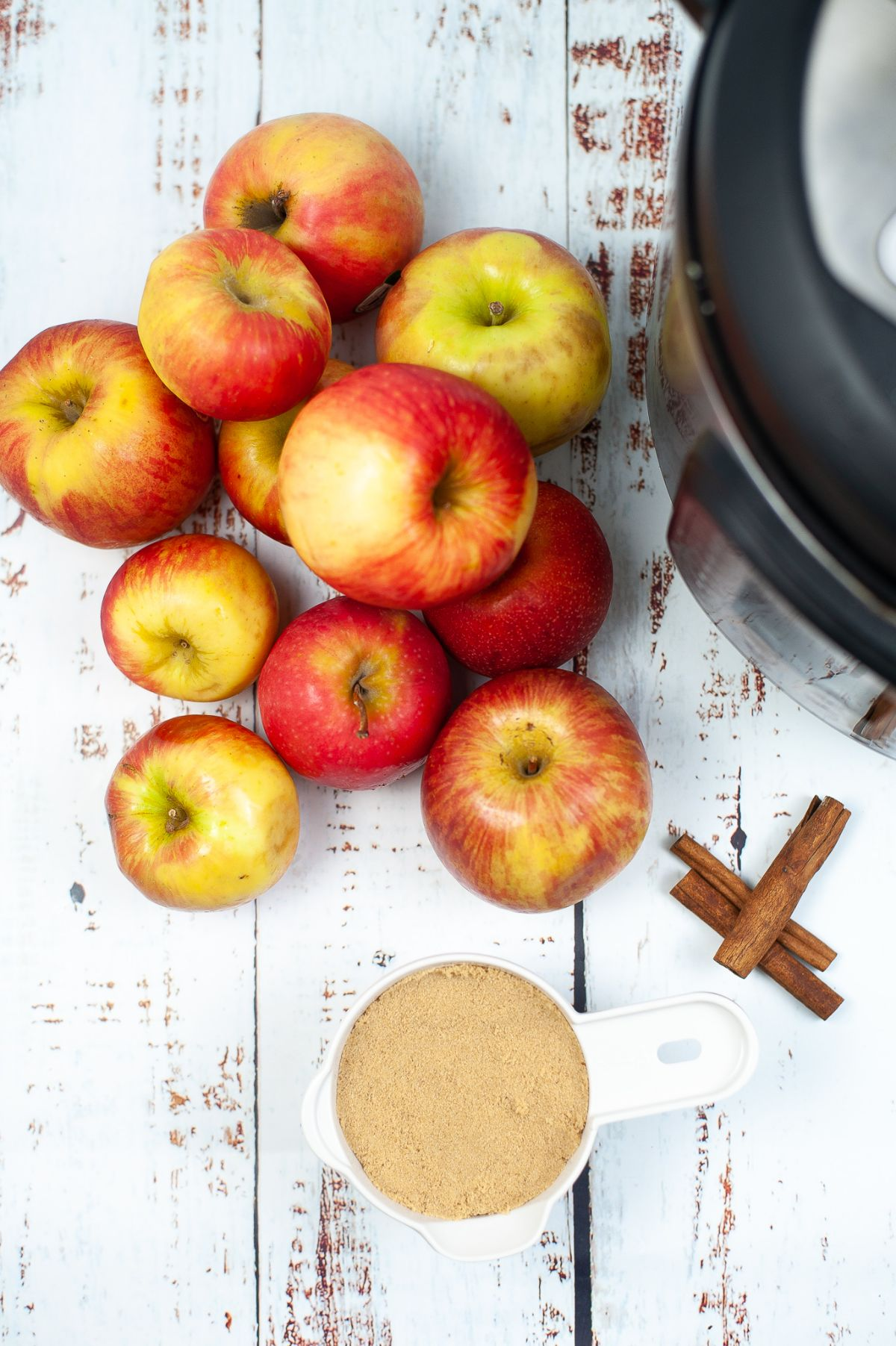 A vertical image of ingredients needed to make Instant Pot Apple Cider