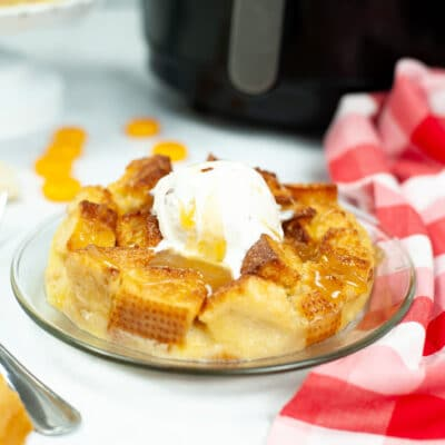 plate of bread pudding topped with butter