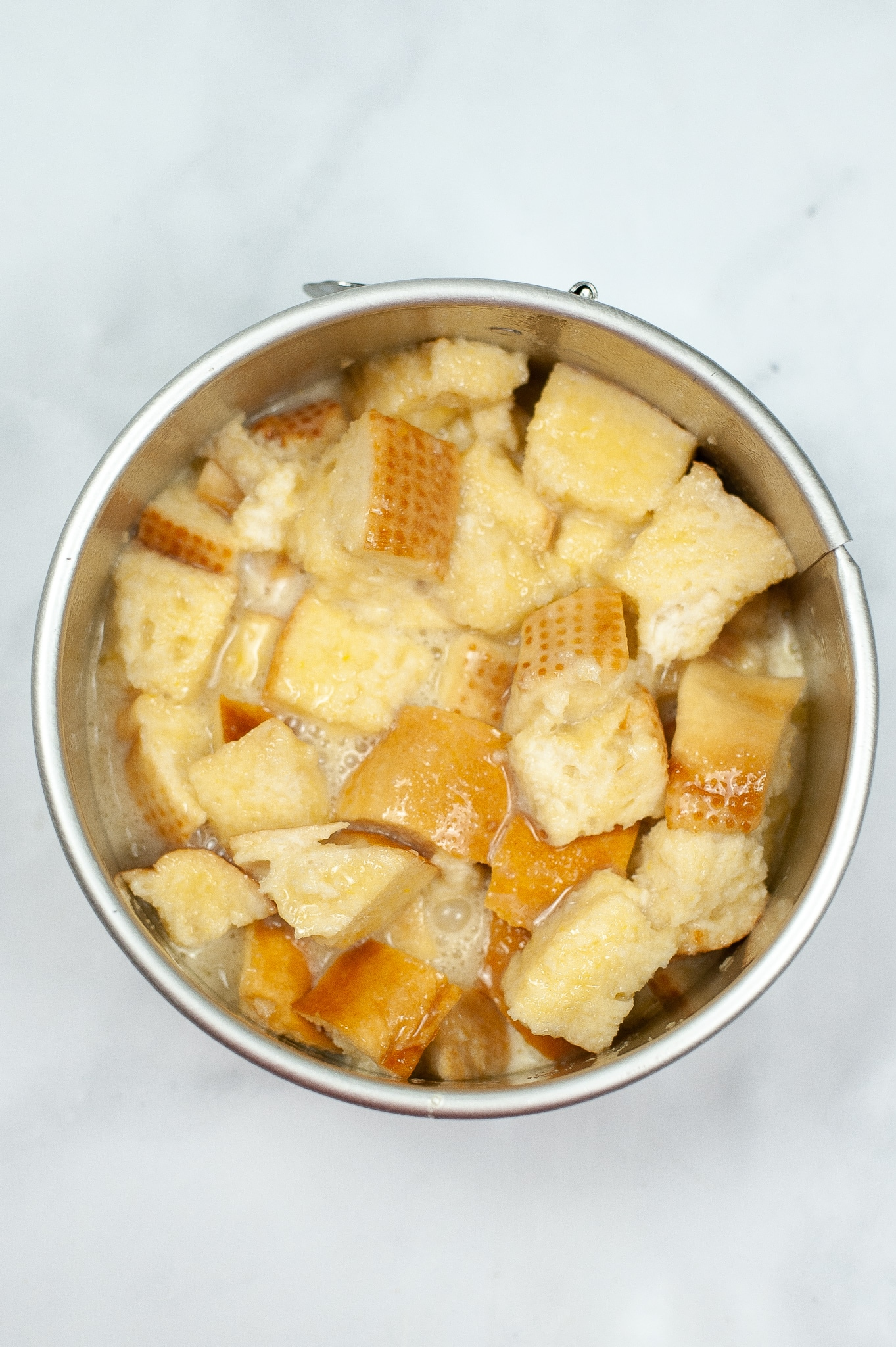 adding bread cubes to the wet ingredients